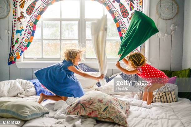 pillow fight - naughty america stock pictures, royalty-free photos & images