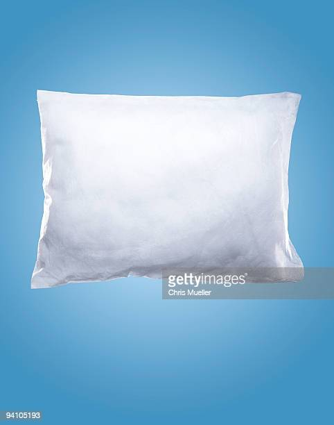 pillow on blue background - pillow stock photos and pictures