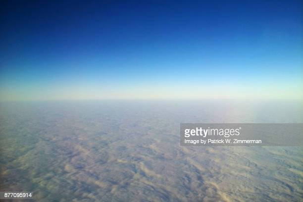 Pillowed earth curvature from the air - stratocumulus clouds