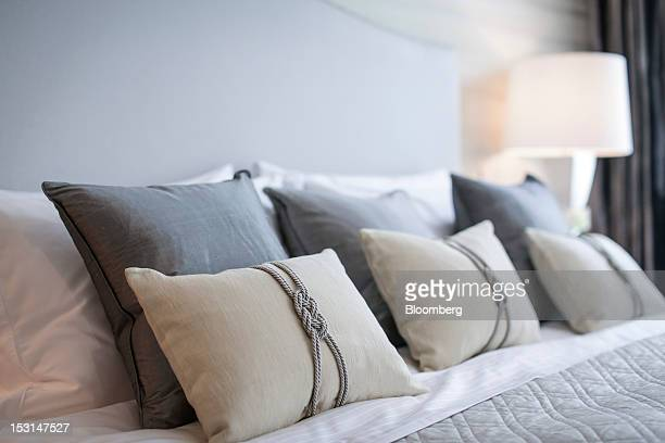 Pillows are seen arranged on a bed in a new home at The Chelsea Townhouses a residential housing development by Morpheus London Ltd in the Chelsea...