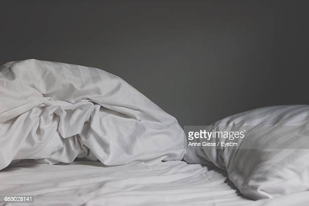 Pillows On Crumpled Bed At Home