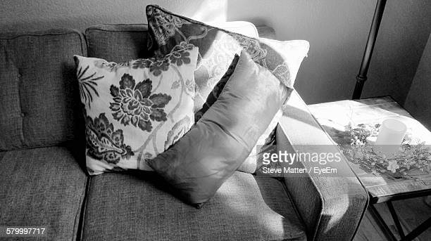 pillows on sofa at home - steve matten stock pictures, royalty-free photos & images