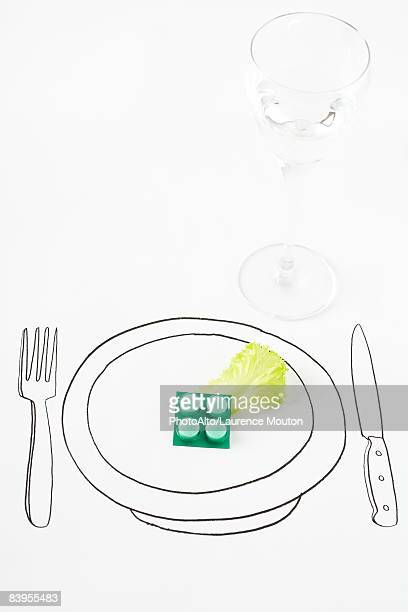 pills and single leaf of lettuce on drawing of plate - eating disorder stock pictures, royalty-free photos & images