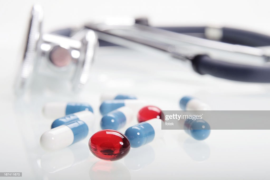 Pills and stethoscope : Stock Photo