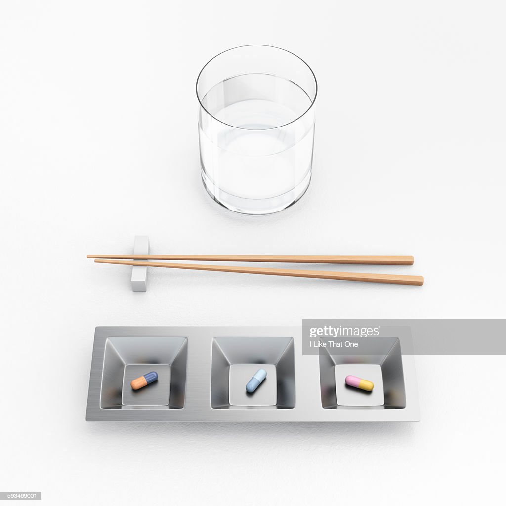 Pills / capsules arranged in a tray with chopstick : Stock Photo