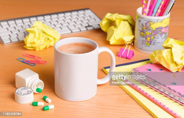 pills helping employee cope with long working hours - caffeine stock pictures, royalty-free photos & images