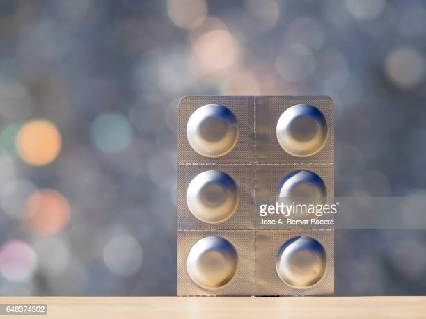 pills in blister pack illuminated by the light of the sun - blister package stock pictures, royalty-free photos & images