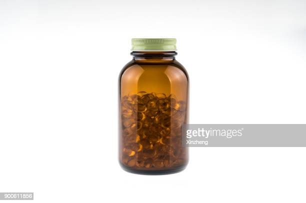 pills in bottle - nutritional supplement stock pictures, royalty-free photos & images