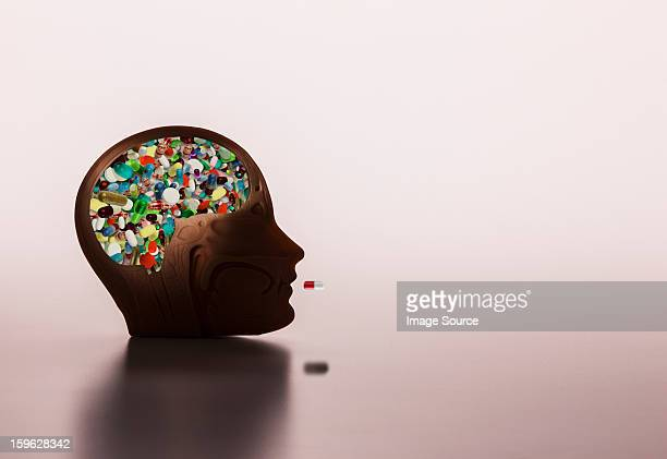 pills in model head - brain  stock pictures, royalty-free photos & images