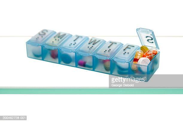 Pills inside open dispenser
