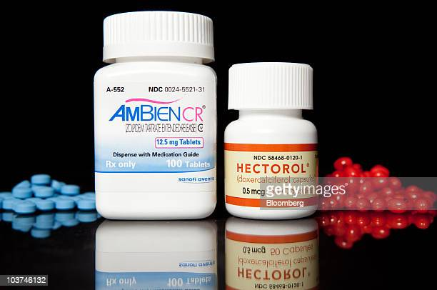 Pills of Genzyme Corp's chronic kidney disease treatment Hecterol right and SanofiAventis SA's insomnia medicine Ambien are arranged for a photo at...