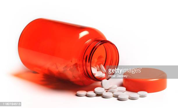 pills spilling out of open pill bottle - medicine stock pictures, royalty-free photos & images