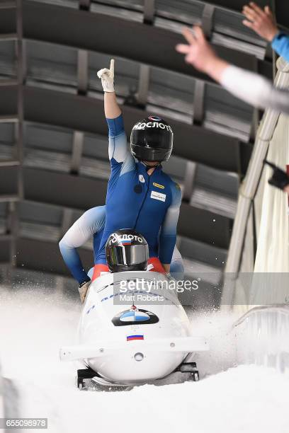 Pilot Alexander Kasjanov of Russia celebrates with Aleksei Pushkarev Vasiliy Konsratenko and Alexey Zaitsev in the 4man Bobsleigh during the BMW IBSF...