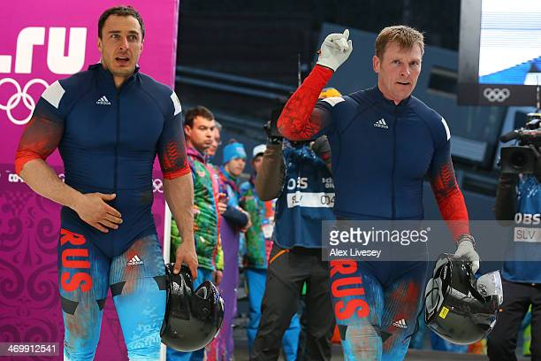 Pilot Alexander Zubkov and Alexey Voevoda of Russia team 1 celebrate as they finish a run during the Men's TwoMan Bobsleigh on Day 10 of the Sochi...