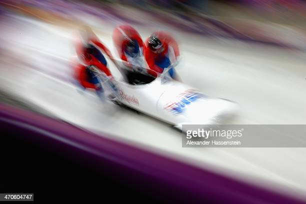 Pilot Alexander Zubkov of Russia starts with his crew a fourman bobsleigh practice session on Day 13 of the Sochi 2014 Winter Olympics at Sliding...