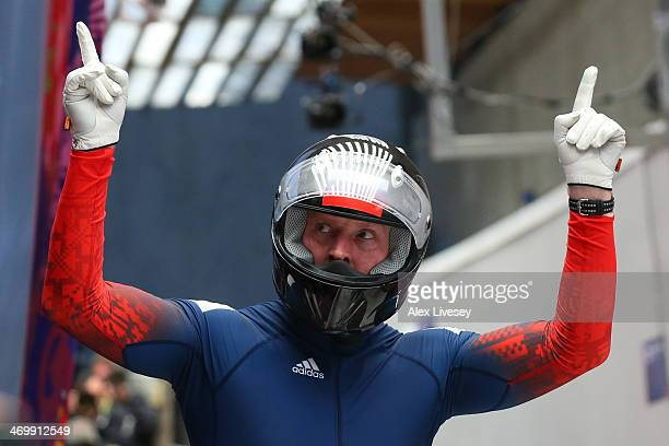 Pilot Alexander Zubkov of Russia team 1 celebrates he finishes a run during the Men's TwoMan Bobsleigh on Day 10 of the Sochi 2014 Winter Olympics at...