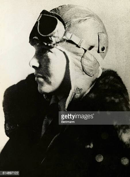Pilot Amelia Earhart wearing a leather flight helmet and goggles