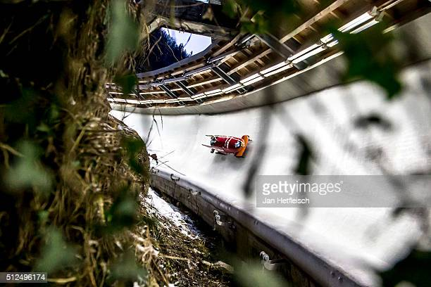 Pilot An Vannieuwenhuyse and her pusher Loes Hubrecht compete in her final bobsleigh run of the women's bobsleigh competition during the BMW IBSF Bob...