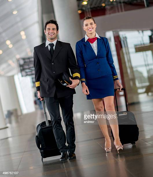 Pilot and air hostess at the airport
