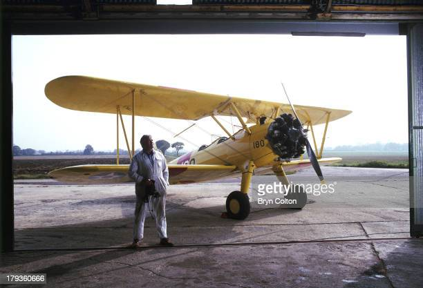 Pilot and aircraft restorer Jim Avis of Eastern Stearman the East Anglian specialists in restoring Boeing Stearman biplane aircraft stands at his...