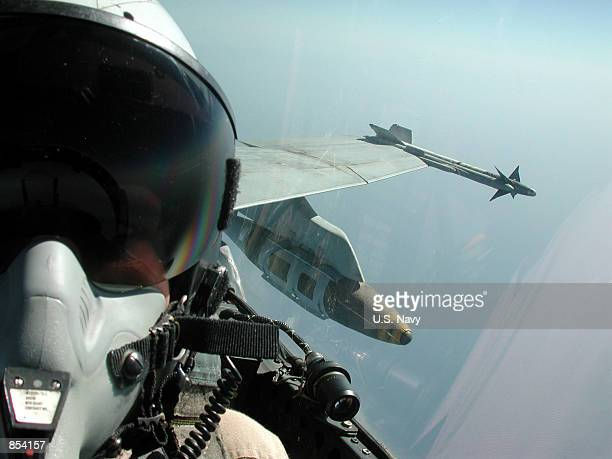 A pilot and an AIM9 'Sidewinder' shortrange airtoair missile are visible on the wing of an F/A18 'Hornet' October 31 2001 in the skies above...