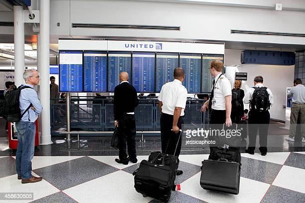 Pilot and Flight Attendant Read Departures Board