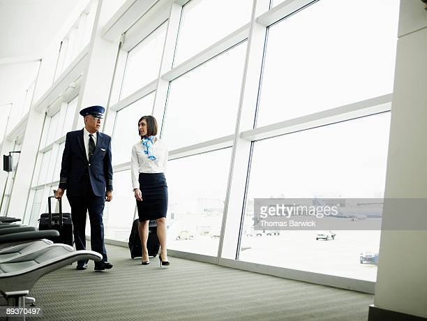Pilot and flight attendant walking to gate