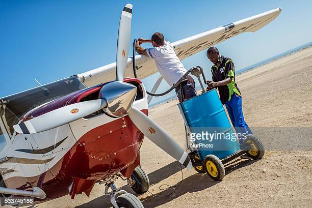 Pilot and his assistant fill a plane before flight at Swakopmund Namibia