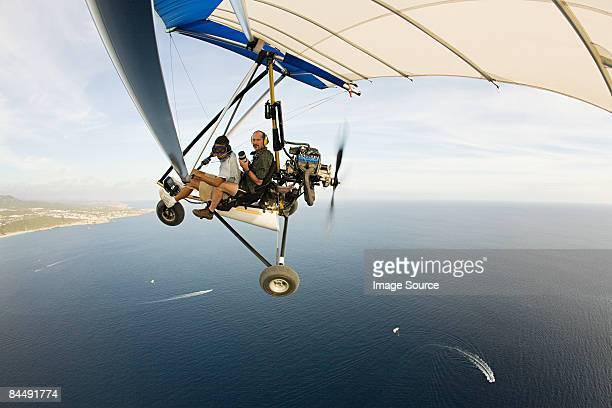 pilot and photographer on ultralight aircraft - aereo ultraleggero foto e immagini stock