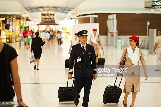 pilot and stewardess of emirates - emirates airline stock photos and pictures