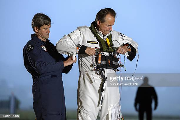 Pilot Andre Borschberg gets ready to fly the Swiss sunpowered aircraft Solar Impulse on May 24 2012 in Payerne on its first attempted...