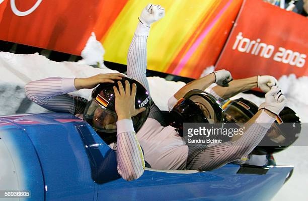 Pilot Andre Lange and teammates Rene Hoppe, Kevin Kuske and Martin Putze of Germany 1 celebrate their gold medal run in the Four Man Bobsleigh Final...