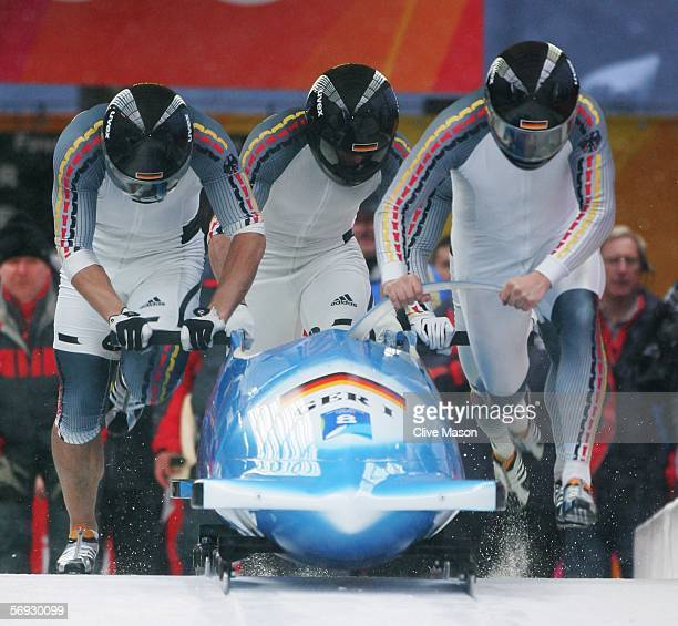 Pilot Andre Lange Rene Hoppe Kevin Kuske and Martin Putze of Germany 1 compete in the Four Man Bobsleigh event on Day 14 of the 2006 Turin Winter...