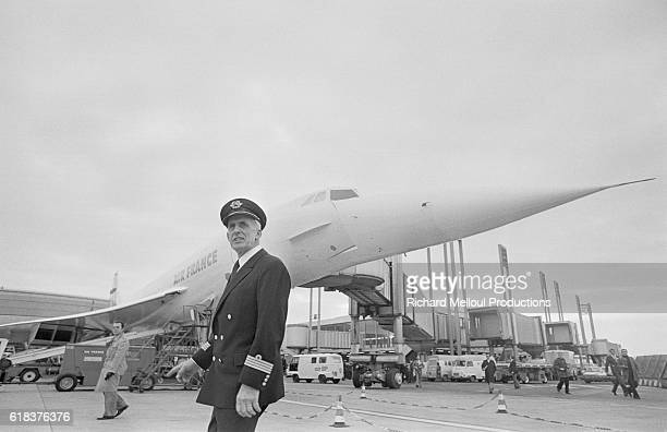 Pilot Andre Turcat stands on the tarmac at Roissy Airport near a Concorde airplane prior to its maiden commercial flight to Rio de Janeiro Turcat...