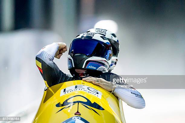 Pilot Anja Schneiderheinze and her pusher Annika Drazek of Germany react after the final run of the women's bobsleigh competition during the BMW IBSF...