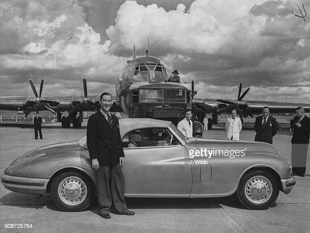 Pilot Arthur John 'Bill' Pegg standing next to his car after flying the giant Bristol Brabazon airliner in Bristol September 3rd 1949