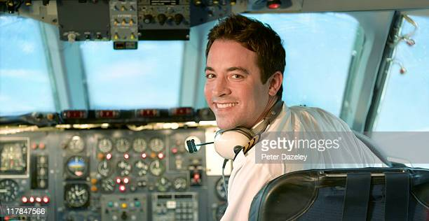 Pilot at control of jet aeroplane
