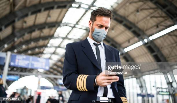pilot at the airport before the take off with the mask - crew stock pictures, royalty-free photos & images