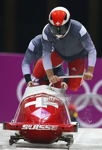 Pilot Beat Hefti and Alex Baumann of Switzerland team 1 make a run during the Men's TwoMan Bobsleigh heats on Day 9 of the Sochi 2014 Winter Olympics...