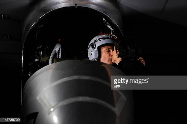 Pilot Bertrand Piccard kisses his wife Michele before take off on the Swiss sunpowered aircraft Solar Impulse on June 5 2012 at the Barajas airpot in...
