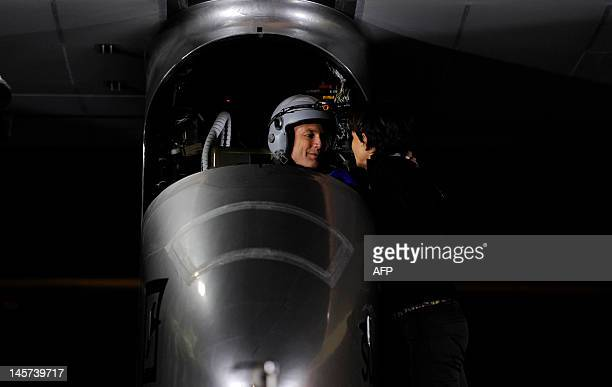 Pilot Bertrand Piccard speaks to his wife Michele before take off on the Swiss sunpowered aircraft Solar Impulse on June 5 2012 at the Barajas airpot...