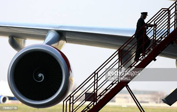 A pilot boards the Virgin Atlantic Boeing 747 before it embarks on the first test flight using biofuel made from coconut oil at Heathrow Airport...