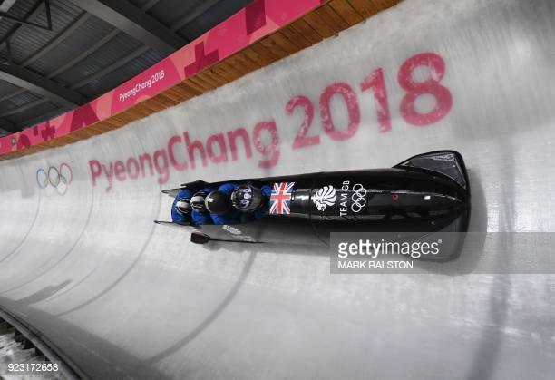 Pilot Brad Hall of Great Britain corners at turn 14 in their 4man bobsleigh training session during the Pyeongchang 2018 Winter Olympic Games at the...