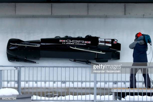 Pilot Bradley Hall of Great Britain crashes with his team mates Joel Fearon Bruce Tasker and Gregory Cackett at the second run of the IBSF World...