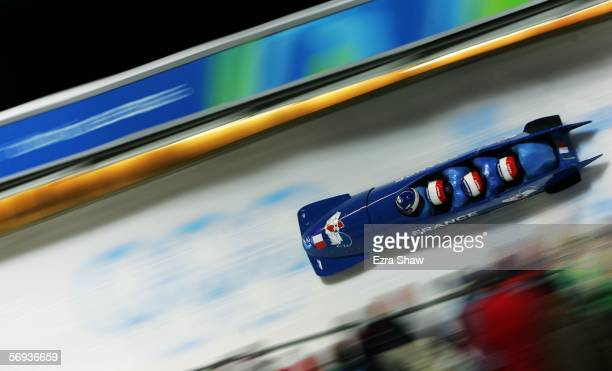 Pilot Bruno Mingeon and teammates Christophe Fouquet, Pierre-Alain Menneron and Alexandre Vanhoutte of France 1 compete in the Four Man Bobsleigh...