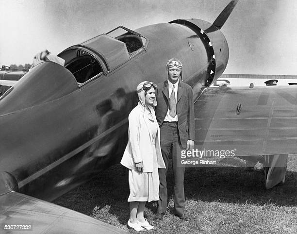 Pilot Charles Lindbergh and his wife Anne stand by their plane after arriving at Curtiss Airport in Glenview Illinois