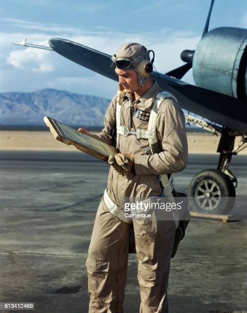 Pilot checking his logbook Los Angeles California 1949