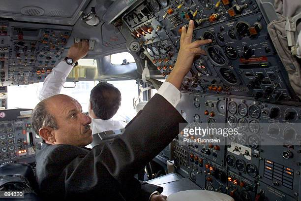 A pilot checks controls in the cockpit of the Ariana Afghan Airlines 727 before it makes the airlines'' first international flight from Kabul Airport...