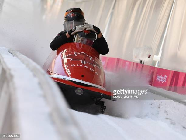 TOPSHOT Pilot Chris Poloniato of Canada with his team after crossing the finish line in the 4man bobsleigh training during the Pyeongchang 2018...