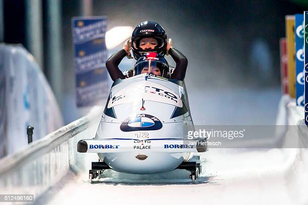 Pilot Christina Hengster and her pusher Sanne Monique Dekker react after the final run of the twowomen bobsleigh competition during the BMW IBSF Bob...